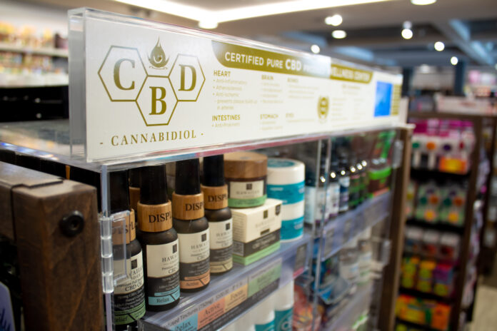 CBD producers products on display in store. Photo by Kevin McGovern.